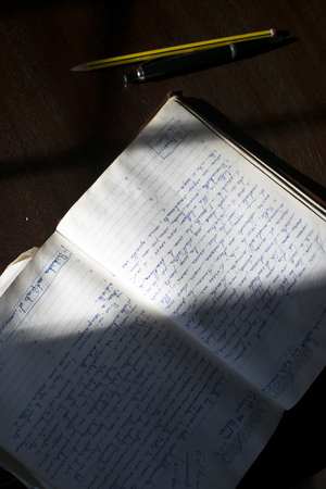 old manuscript diary illumined from lateral light 스톡 콘텐츠