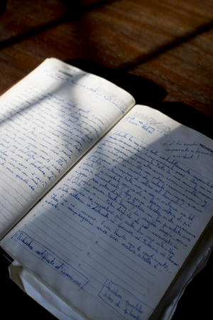 old manuscript diary illumined from lateral light Stock Photo