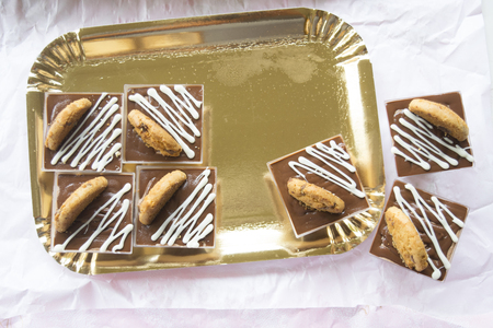 miniature pastry made with melted chocolate and decorated with whipped cream