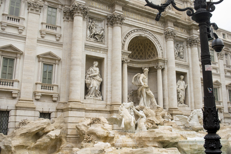 detail of the facade of the fountain of trevi in Rome
