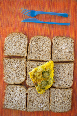 sliced wholemeal sandwich bread and zucchini omelete for a fast meal Stock Photo