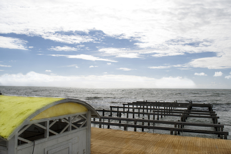 sea in winter time with a wooden pier Stock Photo