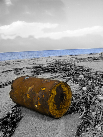 beach in Calabria polluted from litter in a monochome photo with a few parts at color Banco de Imagens