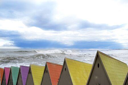 foamy sea wave against a overcast sky Stock fotó