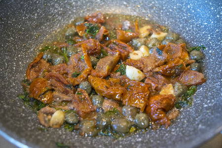 calabrese style sauce with sun-dried tomatoes capers and green olives
