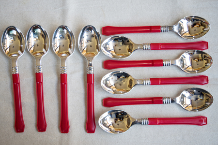 composition of silver dessert spoons with colored handle