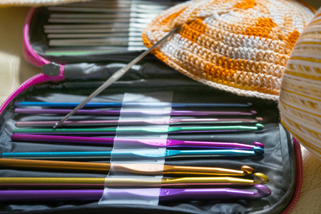 preparing a bikini with tools for crochet and colored skein 写真素材