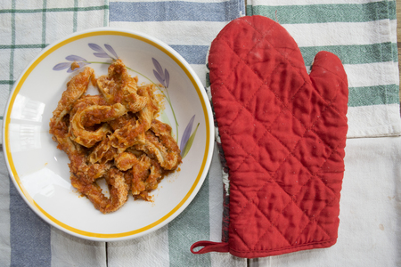 roman-style tripe with tomato sauce in a dish on some colored napkins