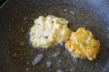 vegetarian fritters frying in pan with boiling oil