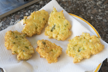 vegetarian crispy fritters just fried and disposed on absorbent kitchen towel