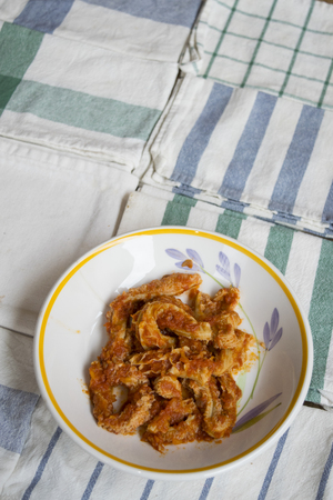dish of roman style tripe on colored napkins