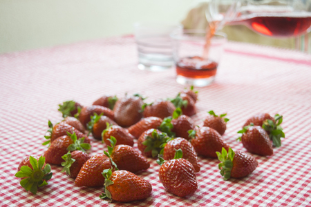 fresh strawberries and a carafe of fruit juice