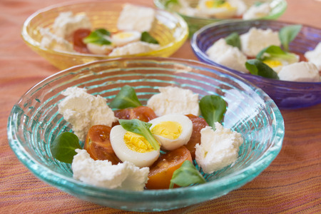 mixed appetiser with spreadable cheese, hard boiled eggs and cherry tomatoes Archivio Fotografico - 100673596