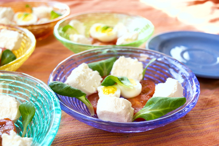 mixed appetiser with spreadable cheese, hard boiled eggs and cherry tomatoes Archivio Fotografico - 100673606