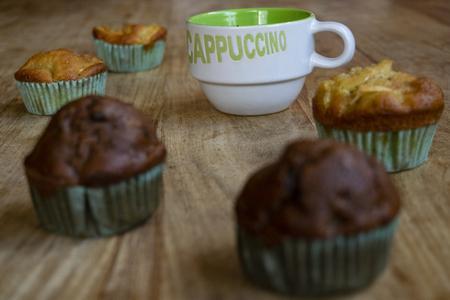 morning  awakening with cappuccino and homemade muffins Standard-Bild - 115910780