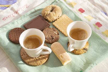 espresso coffee and variety of cookies at breakfast in Italy Standard-Bild - 115910795