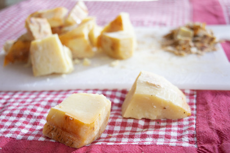 pieces of pecorino cheese of the calabrian shepherds ready to be grated Standard-Bild - 115910765