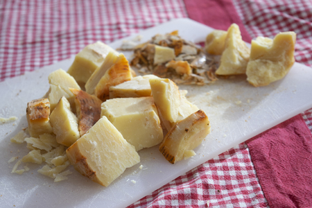 pieces of pecorino cheese of the calabrian shepherds ready to be grated Standard-Bild - 115910767