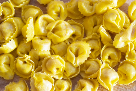 dried raw tortellini stuffed with cured ham Standard-Bild - 115910768
