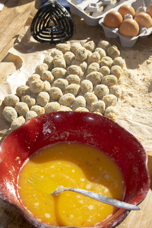 stuffed ascolana olives immersed in the egg during the preparation
