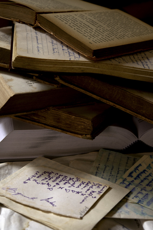 stack of old books with a handwritten diary Stock Photo