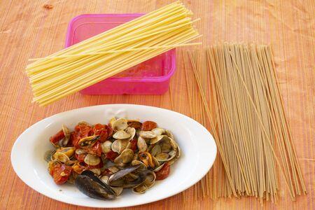 spaghetti allo scoglio with seafood suate