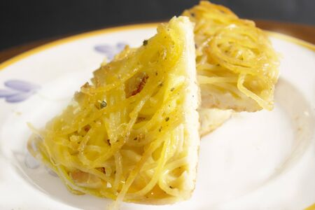 wedge of homemade omelette pasta in a dish