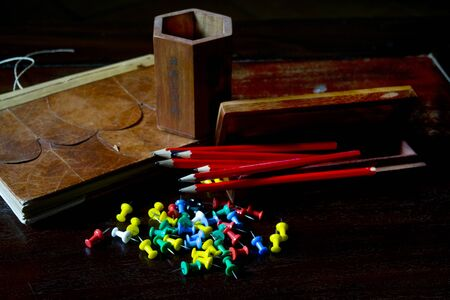 pencils and others stationery objecs on a desk