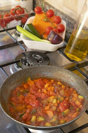 cooking vegetable ragout in pan Archivio Fotografico