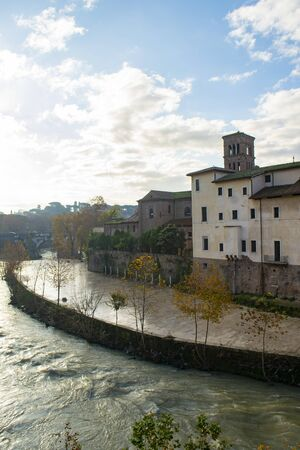 Tiber island in Rome with the Tiber river