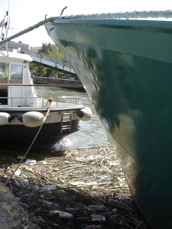 waste in the canal of the small harbour of fiumicino near Rome