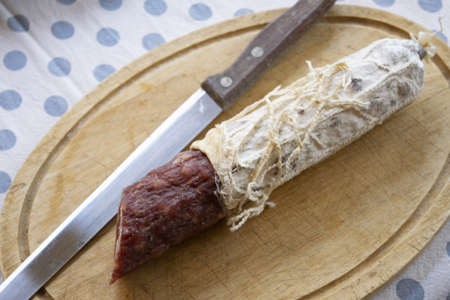 hot ungarian salami on a wooden cutting board Stockfoto