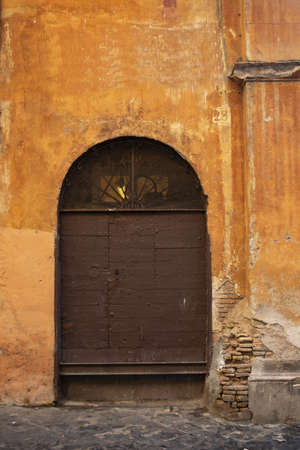 old wooden portal in the historic center of Rome