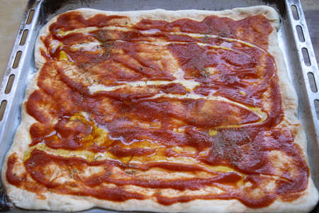 light pizza with tomato sauce and olive oil