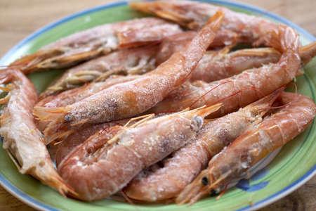 heap of frozen prawns in a dish
