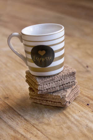 chocolate cookies with an espresso cup on a wooden table Stockfoto