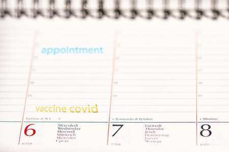 covid vaccine reminder concept with an agenda with the appointment date