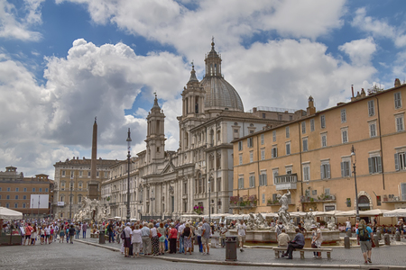 place of interest: Rome, Italy - July 12, 2014: Piazza Navona place of tourist interest in the capital of Italy. Many tourists visit the square.