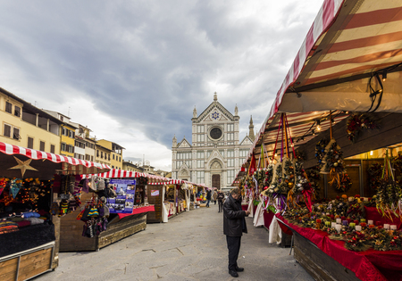 Florence, Italy - December 2013: from the city of Heidelberg in Germany in Piazza Santa Croce in Florence: Weihnachtsmarkt, the typical German Christmas market in Piazza Santa Croce in Florence.In the stalls are sold decorations for the Christmas tree a