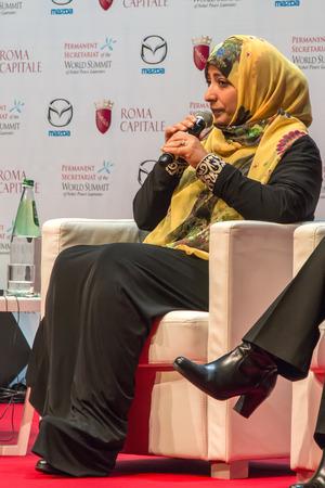 laureates: Rome, Italy - December 13, 2014: World Summit of Nobel Peace Laureates 2014. Tawakkul Karman, Yemeni political activist, during his speech at the World Conference of the Nobel Peace Laureate