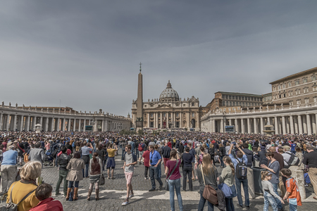 Rome, April 13, 2014: Many faithful fill St. Peters Square on Palm Sunday during the Eucharistic blessing of Pope Francis. April 13, 2014, Vatican City, Italy Editorial