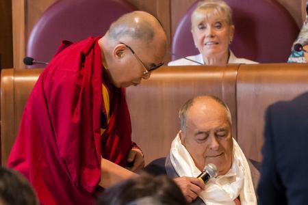 tibetian: Rome, Italy - December 14, 2014: The Dalai Lama presented the Peace Summit Award to Italian film director Bernardo Bertolucci.