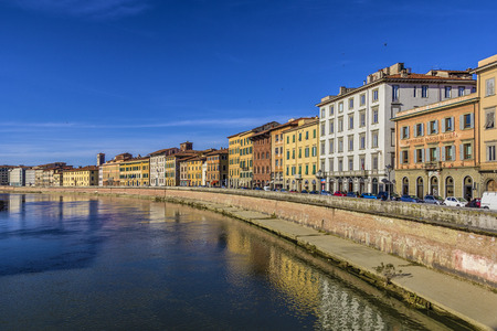 a foreshortening of the typical buildings of the river Arno in Pisa - Italy