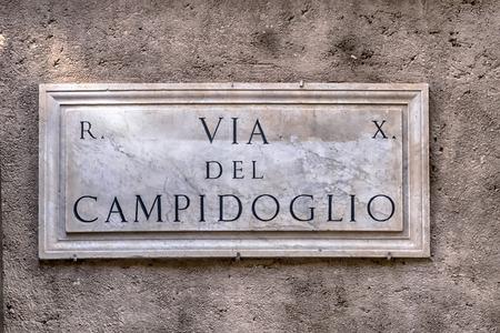 teaches: Marble teaches that indicates Via del Campidoglio Stock Photo