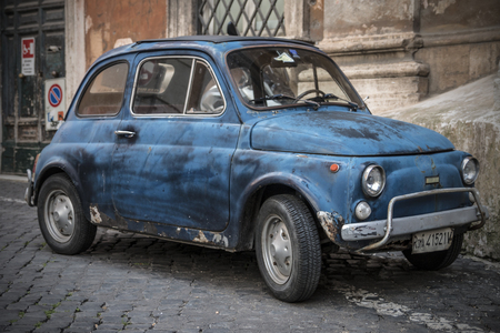 fiat: Rome, Italy - May 4, 2014: Fiat 500 parked in Rome on May 4, 2014. The Fiat 500 was one of the most produced European cars. She has been manufactured over the years in years 1957-1975 - Rome, May 4, 2014