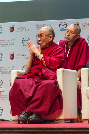 dalai: Rome, Italy - December 13, 2014: World Summit of Nobel Peace Laureates 2014. The Dalai Lama during his speech to the conference at the autidoriom Parco della Musica in Rome