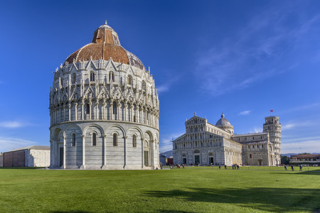 View of the baptistery, the cathedral and the leaning tower in square of miracles in Pisa