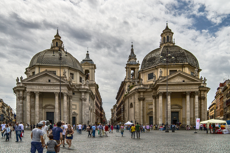 Rome, Italy - May 25, 2014: Many tourists who visit the Piazza del Popolo and the churches twin dedicated to Santa Maria in Santa Maria montesanto miracles and May 25, 2014 in Rome, italy