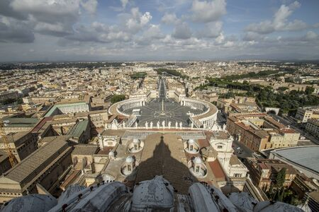 Aerial view of the buildings and streets from the roof point of The Papal Basilica of St. Peter in Vatican city, Italy