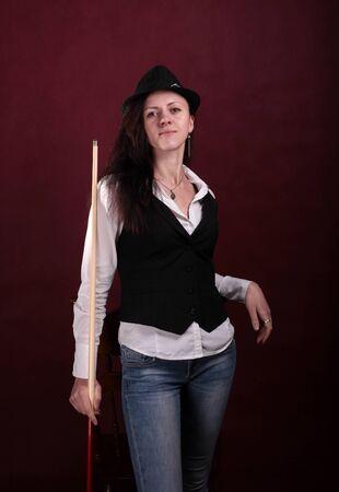 cue: girl in a black vest with a billiard cue